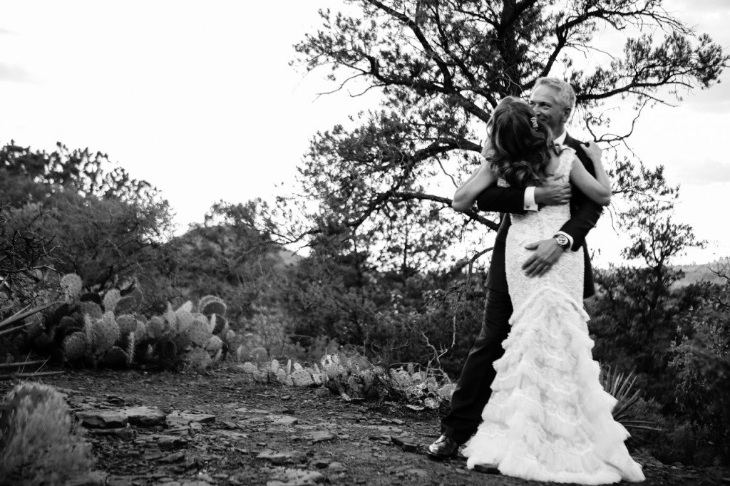 sedona destination wedding outdoors bride and groom black and white embrace